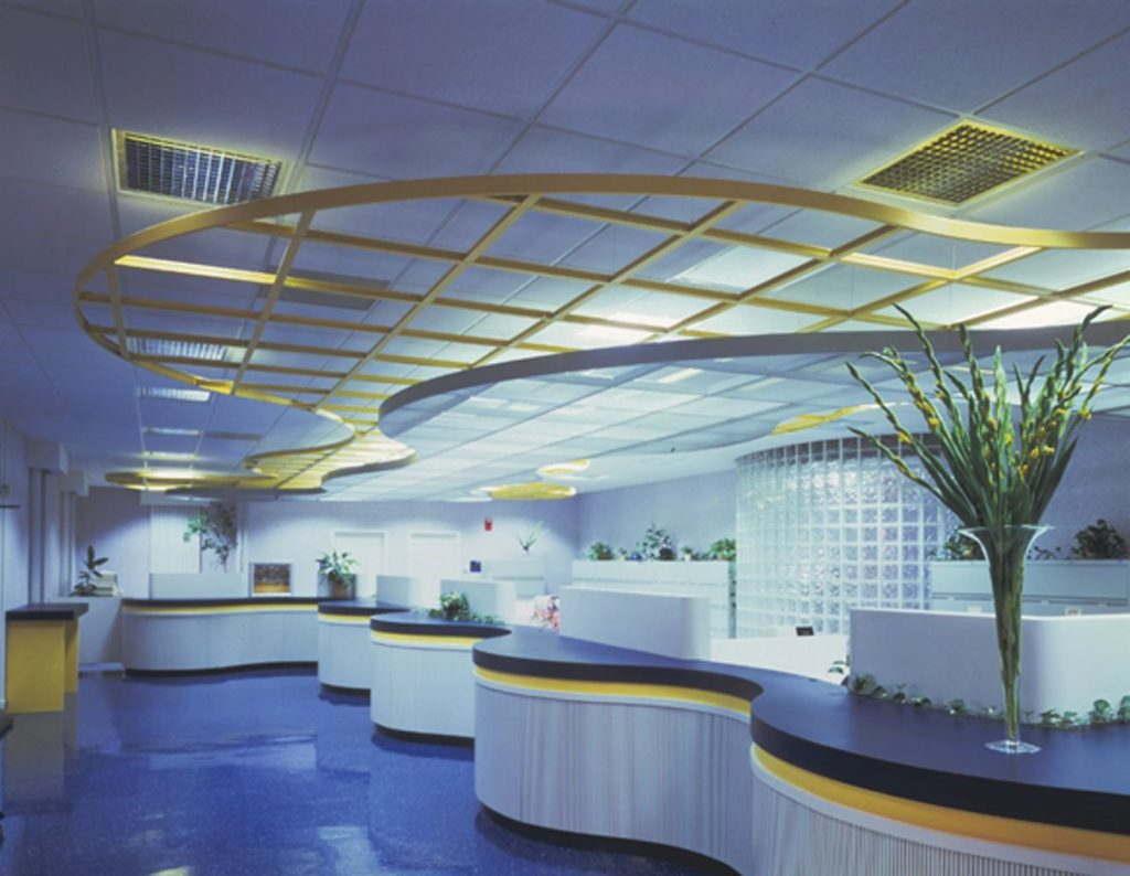 Photo of Ceiling System with Curved Edge Trim called Compasso.