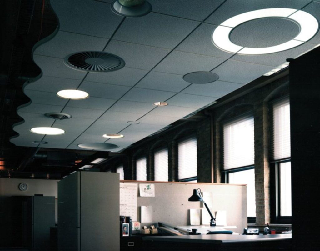 Suspended ceiling system with grid circles at different intersections for lighting, air diffusers, and accents. Kit of parts would include pre-cut ceiling panels to fit.